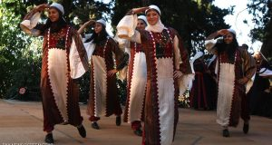 Palestinian women in traditional dresses